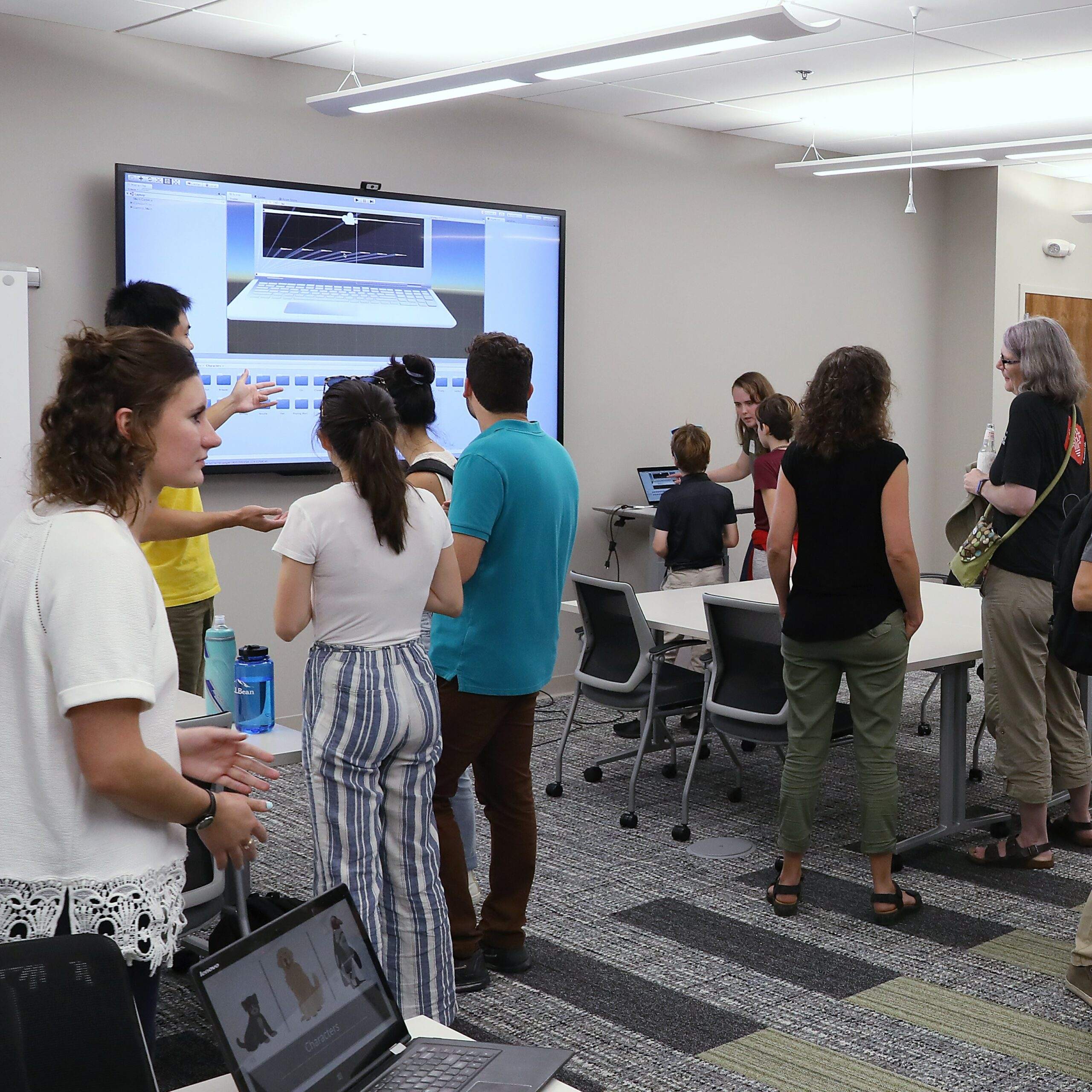 college students showing work in conference room
