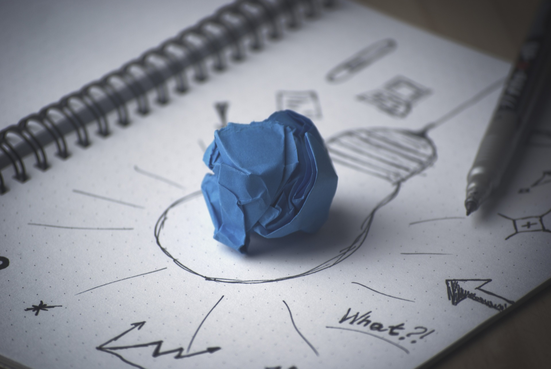 blue putty on sketch paper with drawing of lightbulb